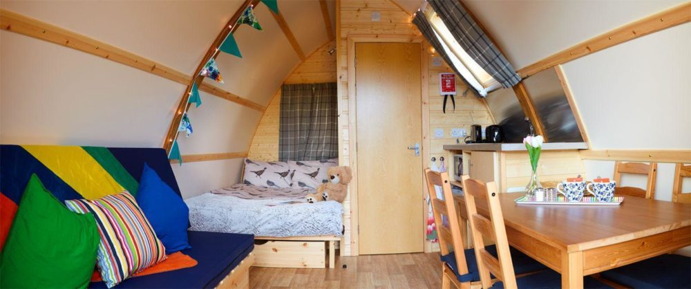 Interior of a Running Water Deluxe Wigwam with bedding