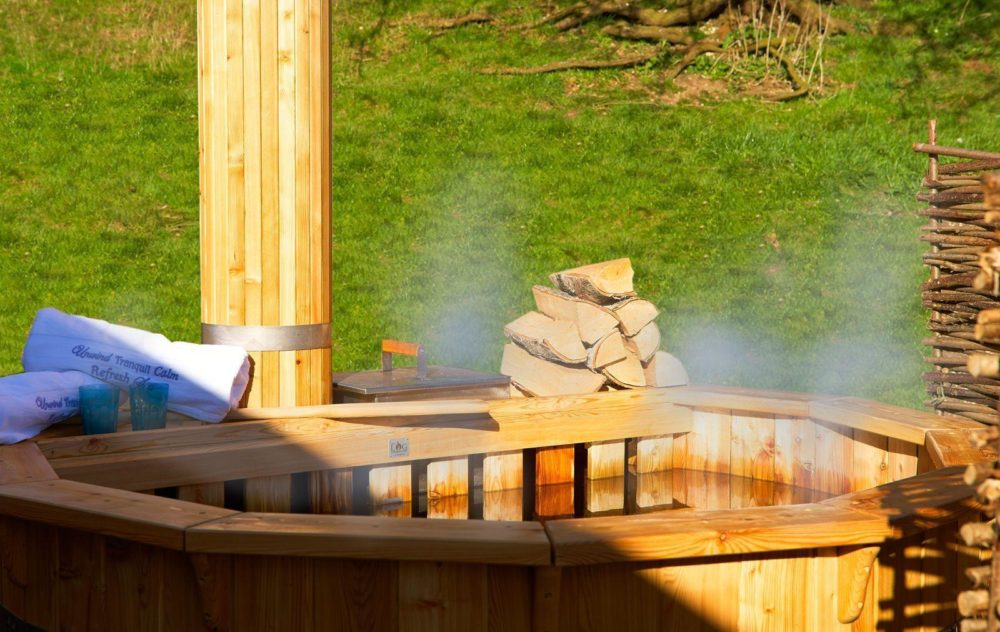 Log Fired Hot Tub at the Deluxe Wigwams