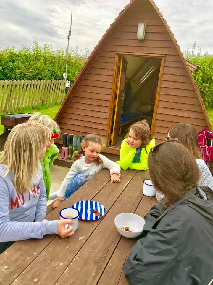Some of our guests enjoying breakfast outside their wigwam!