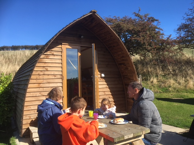 Guests enjoying their Deluxe Wigwam